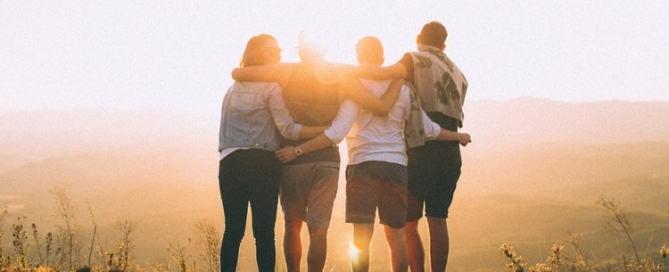Group of people looking at a sunset